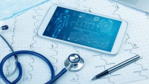 phone on table with stethoscope